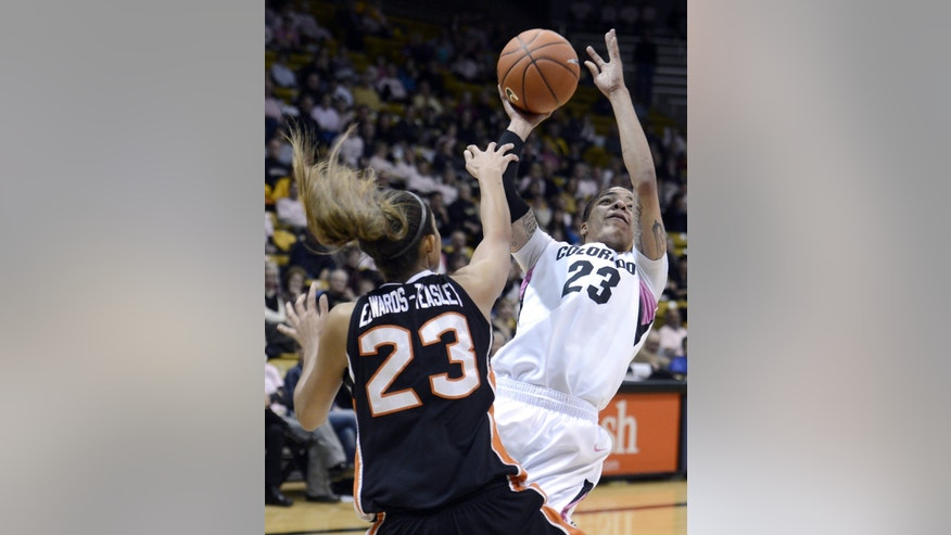 Colorado's Chucky Jeffery takes a shot over  Oregon State's ShaKiana Edwards-Teasley during an NCAA college basketball game Friday, Feb. 8, 2013 in Boulder, Colo.  (AP Photo/Daily Camera, Jeremy Papasso)