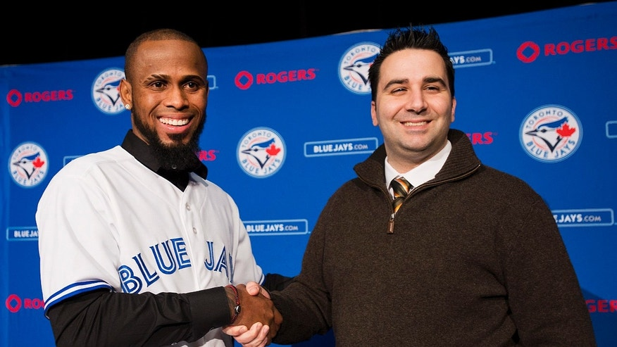 ADVANCE FOR WEEKEND EDITIONS, FEB. 9-10 - FILE - In this Jan. 17, 2013, file photo, Toronto Blue Jay new shortstop Jose Reyes, left, shakes hands with general manager Alex Anthopoulos during a baseball news conference in Toronto. rom Joker Marchant Stadium in Lakeland, Fla., to HoHoKam Park in Mesa, Ariz., bats and balls will be broken out next week when teams start reporting for spring training. (AP Photo/The Canadian Press, Aaron Vincent Elkaim, File)