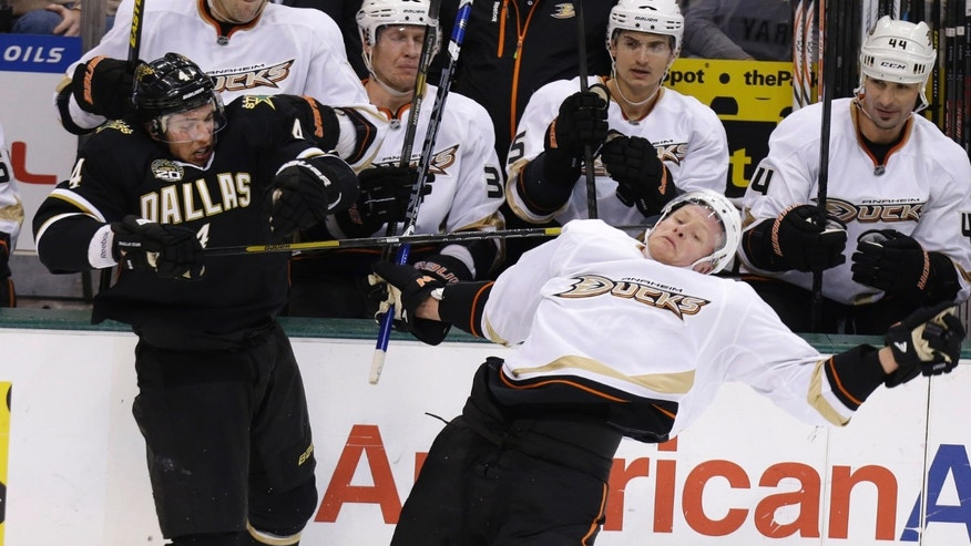 Dallas Stars defenseman Brenden Dillon (4) and Anaheim Ducks right wing Corey Perry (10) try to regain their balance after colliding into each other during the second period of an NHL hockey game Friday, Feb. 8, 2013, in Dallas. (AP Photo/LM Otero)