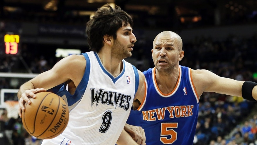 Minnesota Timberwolves' Ricky Rubio of Spain, left, drives around New York Knicks' Jason Kidd  in the first period of an NBA basketball game Friday, Feb. 8, 2013 in Minneapolis. (AP Photo/Jim Mone)