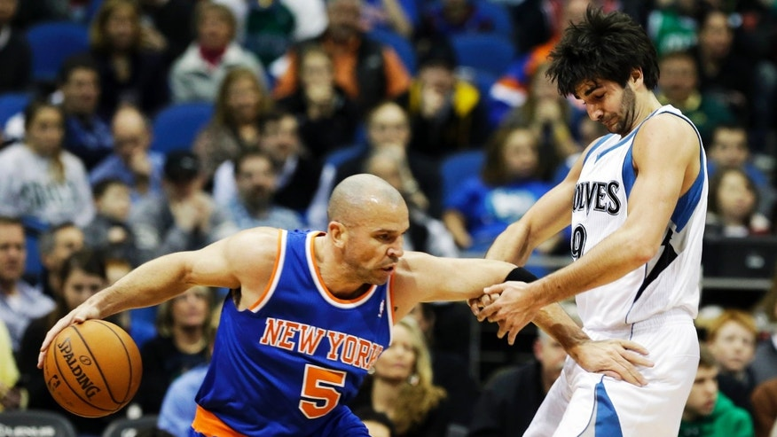 New York Knicks' Jason Kidd, left, pushes Minnesota Timberwolves' Ricky Rubio of Spain out of the way as he drives in the first period of an NBA basketball game Friday, Feb. 8, 2013 in Minneapolis. (AP Photo/Jim Mone)