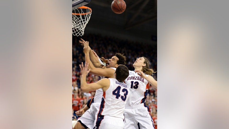 Gonzaga's Elias Harris, Kelly Olynyk (13) and Drew Barham (43) go for a rebound against Pepperdine in the first half of an NCAA college basketball game, Thursday, Feb. 7, 2013, in Spokane, Wash. (AP Photo/Jed Conklin)