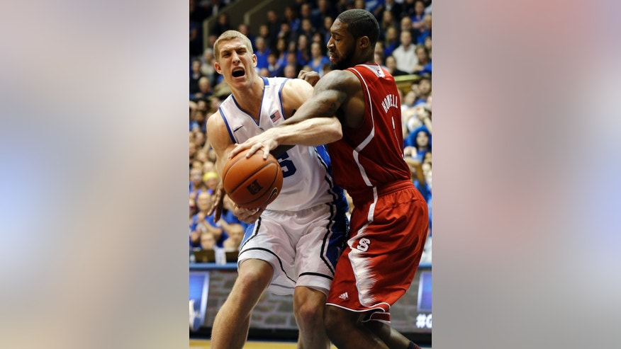 Duke's Mason Plumlee, left, and North Carolina State's Richard Howell struggle for the ball during the first half of an NCAA college basketball game in Durham, N.C., Thursday, Feb. 7, 2013. (AP Photo/Gerry Broome)