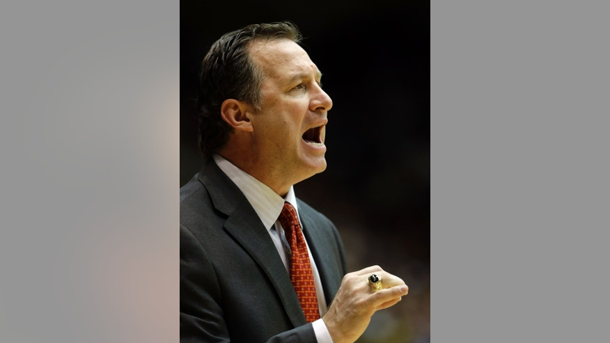 North Carolina State head coach Mark Gottfried reacts during the first half of an NCAA college basketball game against Duke in Durham, N.C., Thursday, Feb. 7, 2013. Duke won 98-85. (AP Photo/Gerry Broome)