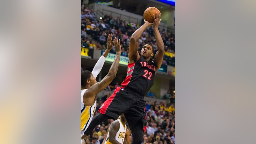 Toronto Raptors small forward Rudy Gay (22) shoots over the Indiana Pacers' defense during the first half of an NBA basketball game in Indianapolis, Friday, Feb. 8, 2013. (AP Photo/Doug McSchooler)