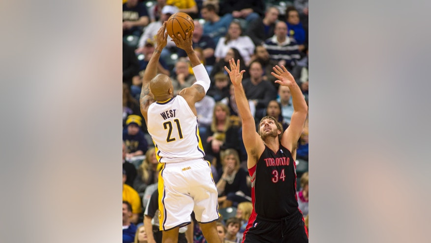 Indiana Pacers power forward David West (21) puts up a three-point shot over the defense of Toronto Raptors center Aaron Gray (34) during the first half of an NBA basketball game in Indianapolis, Friday, Feb. 8, 2013. (AP Photo/Doug McSchooler)