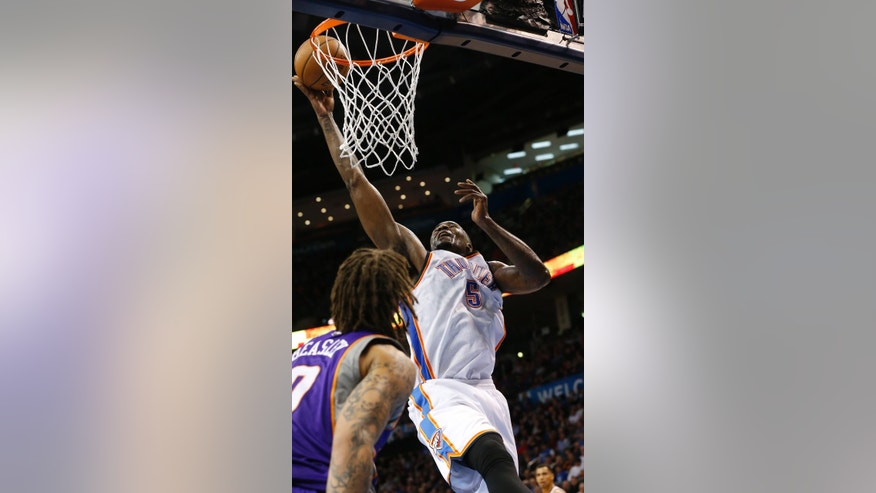 Oklahoma City Thunder center Kendrick Perkins (5) shoots in front of Phoenix Suns forward Michael Beasley (0) in the third quarter of an NBA basketball game in Oklahoma City, Friday, Feb. 8, 2013. Oklahoma City won 127-96. (AP Photo/Sue Ogrocki)