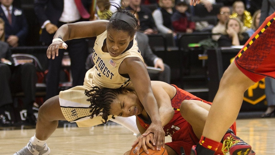 Wake Forest's Asia Williams, top, and Maryland's Tianna Hawkins fight for the loose ball during the second half of an NCAA college basketball game in Winston-Salem, N.C., Friday, Feb. 8, 2013. (AP Photo/Lynn Hey)