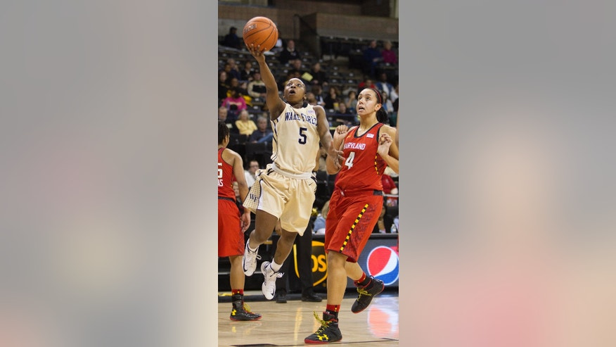 Wake Forest's Chelsea Douglas (5) shoots in transition with Maryland's Malina Howard (4) following during the first half of an NCAA college basketball game in Winston-Salem, N.C., Friday, Feb. 8, 2013. (AP Photo/Lynn Hey)