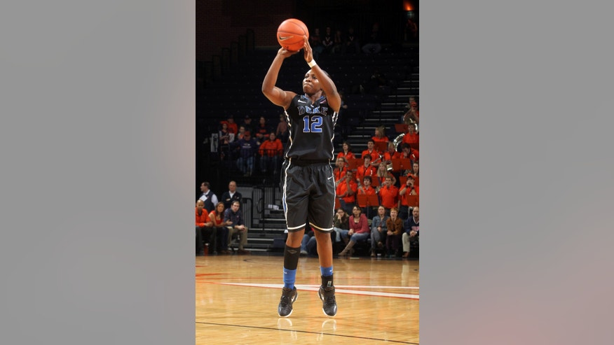 Duke guard Chelsea Gray shoots a 3-pointer during an NCAA college basketball game against Virginia on Friday, Feb. 8, 2013, in Charlottesville, Va. (AP Photo/Andrew Shurtleff)