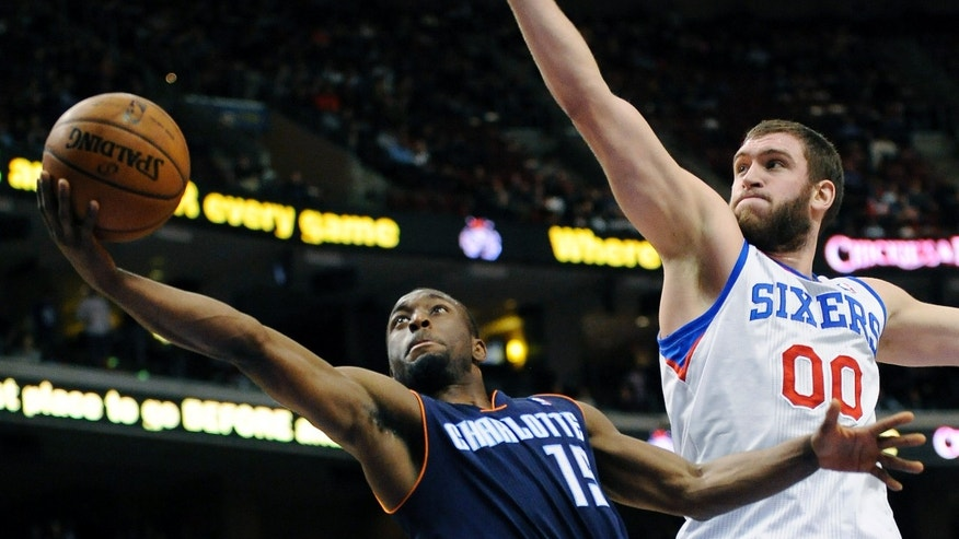Charlotte Bobcats' Kemba Walker (15) drives past Philadelphia 76ers' Spencer Hawes (00) during the first half of an NBA basketball game, Saturday, Feb. 9, 2013, in Philadelphia. (AP Photo/Michael Perez)