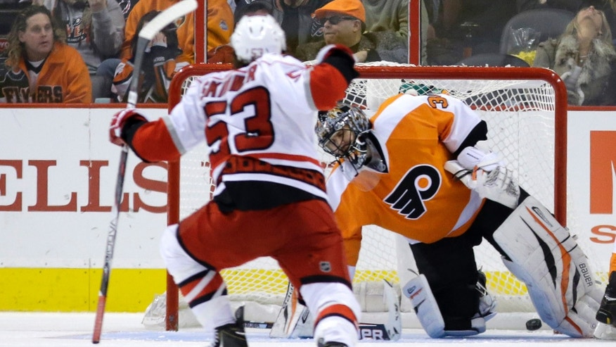 Carolina Hurricanes' Jeff Skinner, left, reacts after scoring a goal past Philadelphia Flyers' Ilya Bryzgalov, of Russia, during the second period of an NHL hockey game, Saturday, Feb. 9, 2013, in Philadelphia. (AP Photo/Matt Slocum)
