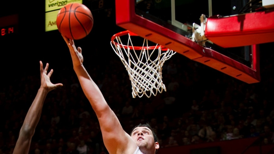 Nebraska's Andre Almeida (32) rebounds over Penn State's Jon Graham (25) and Alan Wisniewski during the first half of their NCAA college basketball game, Saturday, Feb. 9, 2013, in Lincoln, Neb. (AP Photo/The Journal-Star, Matt Ryerson) LOCAL TV OUT; KOLN-TV OUT; KGIN-TV OUT; KLKN-TV OUT