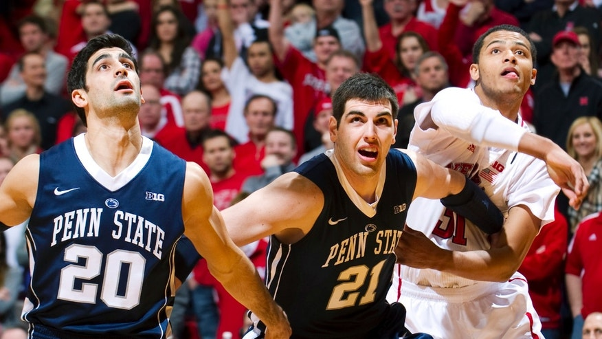 Penn State's Nick Colella (20) and Sasa Borovnjak (21) box out on Nebraska's Shavon Shields (31) during the first half of their NCAA college basketball game, Saturday, Feb. 9, 2013, in Lincoln, Neb. (AP Photo/The Journal-Star, Matt Ryerson) LOCAL TV OUT; KOLN-TV OUT; KGIN-TV OUT; KLKN-TV OUT
