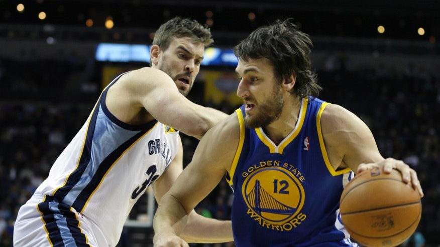 Golden State Warriors' Andrew Bogut (12), of Australia, moves the ball in front of Memphis Grizzlies' Marc Gasol (33), of Spain, during the first half of an NBA basketball game in Memphis, Tenn., Friday, Feb. 8, 2013. (AP Photo/Danny Johnston)