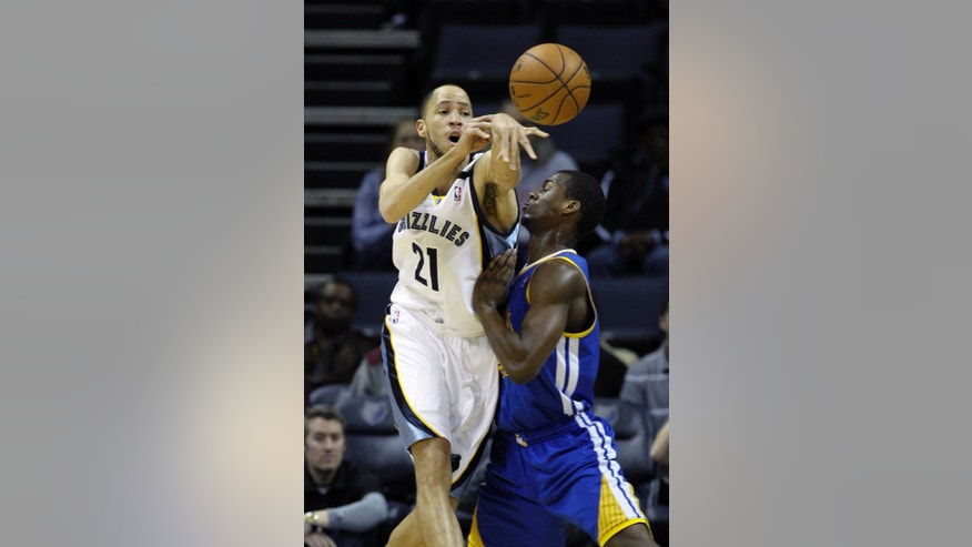 Memphis Grizzlies' Tayshaun Prince (21) passes while pressured by Golden State Warriors' Harrison Barnes during the first half of an NBA basketball game in Memphis, Tenn., Friday, Feb. 8, 2013. (AP Photo/Danny Johnston)