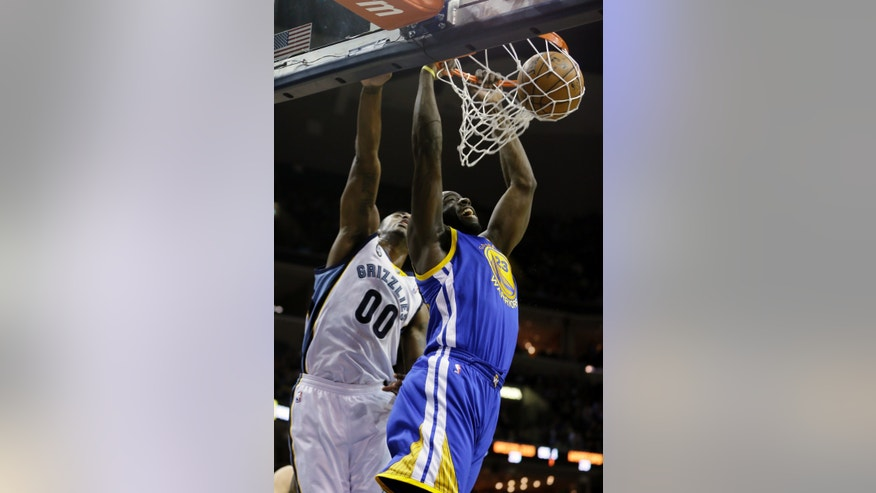 Golden State Warriors' Draymond Green (23) dunks in front of Memphis Grizzlies' Darrell Arthur (00) during the first half of an NBA basketball game in Memphis, Tenn., Friday, Feb. 8, 2013. (AP Photo/Danny Johnston)