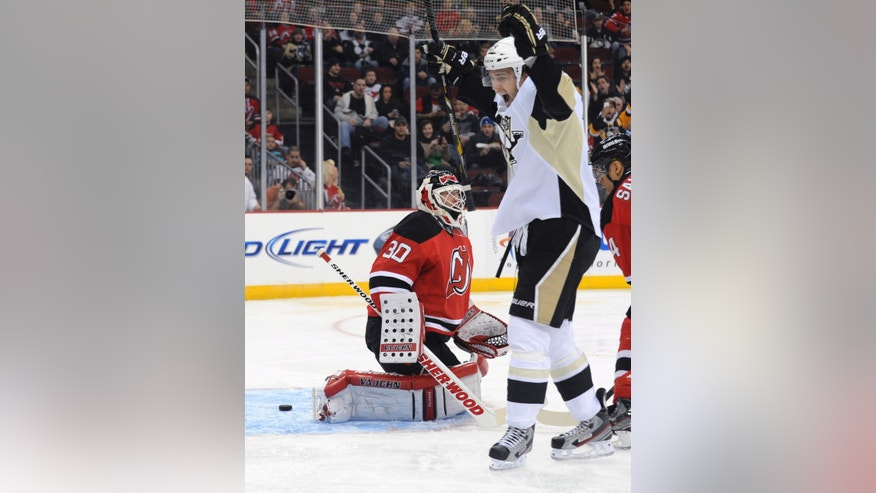 Pittsburgh Penguins, Brandon Sutter, right, celebrates his goal against New Jersey Devils goaltender Martin Brodeur during the first period of an NHL hockey game Saturday, Feb. 9, 2013, in Newark, N.J. (AP Photo/Bill Kostroun)