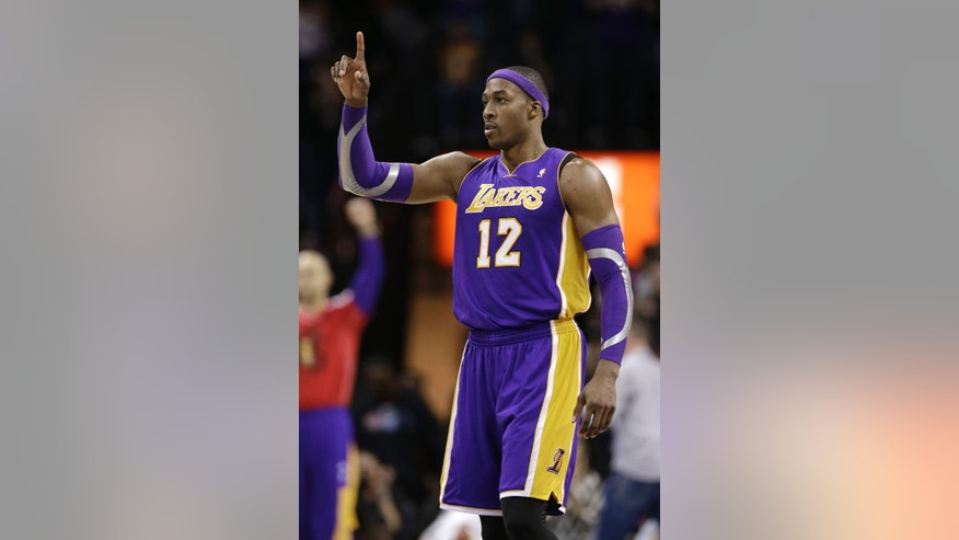 Los Angeles Lakers' Dwight Howard (12) reacts at the end of an NBA basketball game against the Charlotte Bobcats in Charlotte, N.C., Friday, Feb. 8, 2013. The Lakers won 100-93. (AP Photo/Chuck Burton)