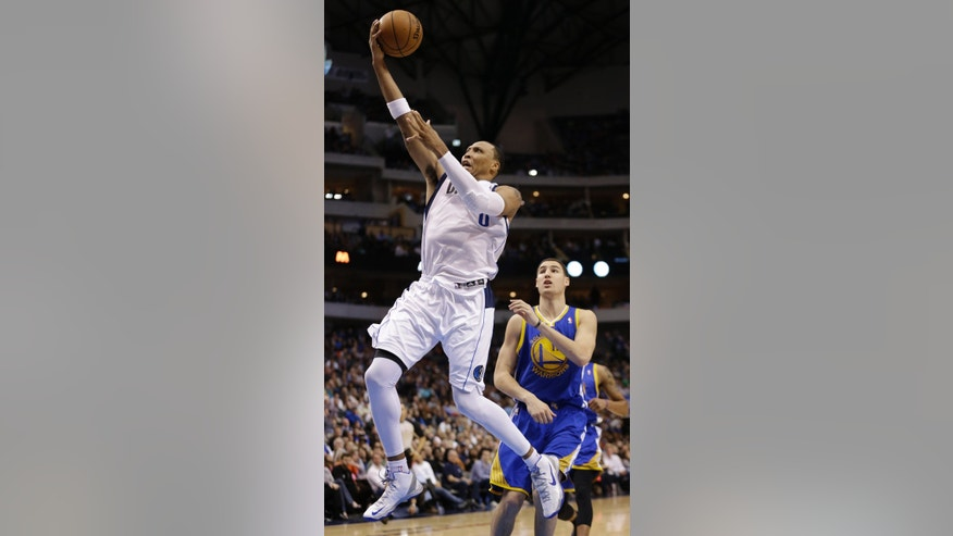 Dallas Mavericks forward Shawn Marion (0) shoots past Golden State Warriors guard Klay Thompson (11) during the second half of an NBA basketball game Saturday, Feb. 9, 2013, in Dallas. The Mavericks won 116-91. (AP Photo/LM Otero)