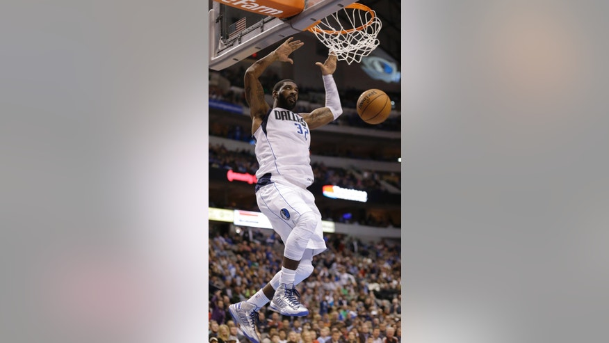 Dallas Mavericks guard O.J. Mayo (32) scores during the second half of an NBA basketball game against the Golden State Warriors Saturday, Feb. 9, 2013, in Dallas. The Mavericks won 116-91. (AP Photo/LM Otero)