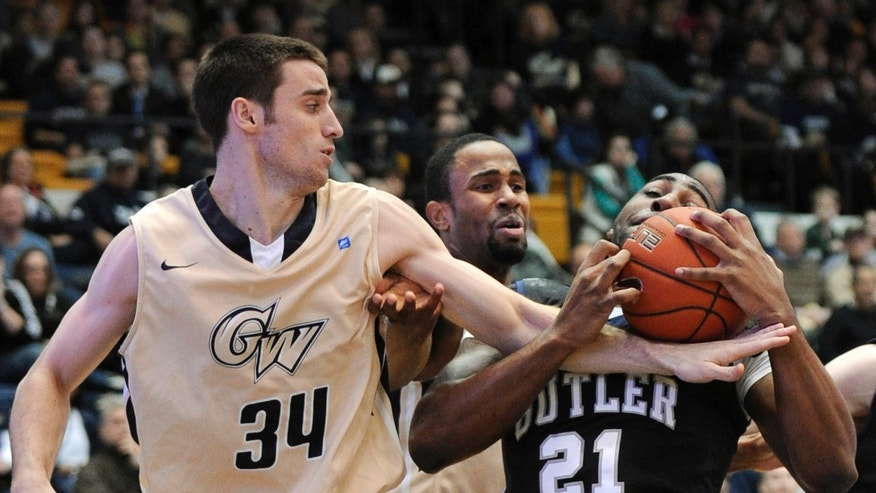 George Washington forward John Kopriva (34) reaches for the ball against Butler forward Roosevelt Jones (21) during the first half of an NCAA college basketball game, Saturday, Feb. 9, 2013, in Washington. (AP Photo/Nick Wass)