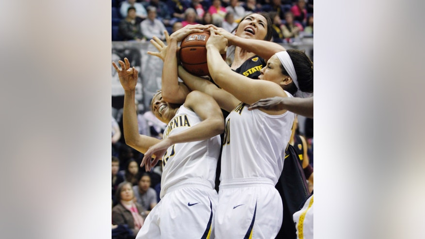 Arizona State's Joy Burke, center, struggles for the ball California's Layshia Clarendon, left, and Mikayla Lyles  during the first half of an NCAA college basketball game in Berkeley, Calif., Friday, Feb. 8, 2013. (AP Photo/George Nikitin)