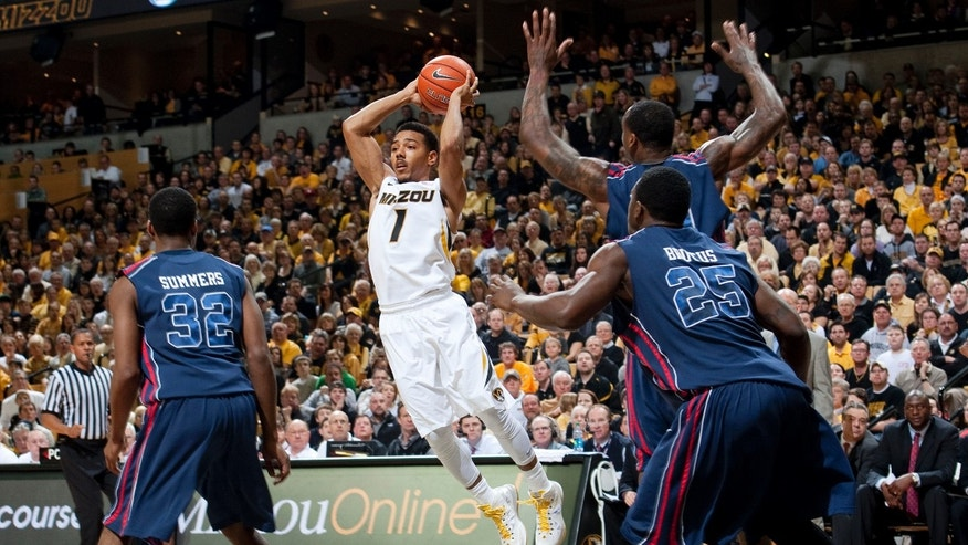 Missouri's Phil Pressey, center, passes the ball between Mississippi's Jarvis Summers, left, Terry Brutus, right front, and Murphy Holloway during the first half of an NCAA college basketball game Saturday, Feb. 9, 2013, in Columbia, Mo. (AP Photo/L.G. Patterson)
