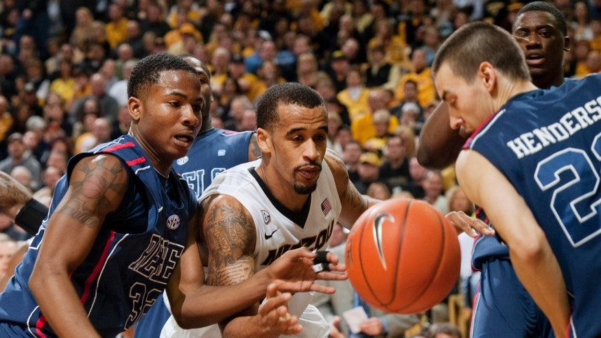 Missouri's Laurence Bowers, center, loses the ball between Mississippi's Jarvis Summers, left, and Marshall Henderson during the first half of an NCAA college basketball game Saturday, Feb. 9, 2013, in Columbia, Mo. (AP Photo/L.G. Patterson)