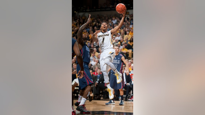 Missouri's Phil Pressey, right, shoots over Mississippi Jarvis Summers  during the first half of an NCAA college basketball game Saturday, Feb. 9, 2013, in Columbia, Mo. (AP Photo/L.G. Patterson)