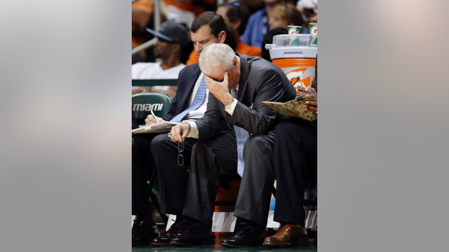 North Carolina coach Roy Williams, center, sits on the bench during the final minutes of an NCCA college basketball game against Miami, Saturday, Feb. 9, 2013, in Coral Gables, Fla. Miami defeated North Carolina 87-61. (AP Photo/Wilfredo Lee)