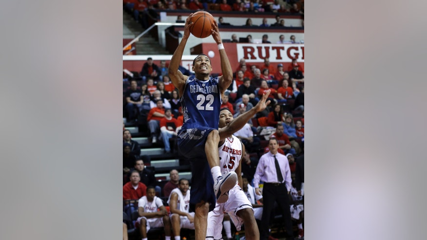 Georgetown's Otto Porter Jr. (22) goes for a basket in front of Rutgers' Derrick Randall (15) during the first half of an NCAA college basketball game Saturday, Feb. 9, 2013, in Piscataway, N.J. (AP Photo/Mel Evans)