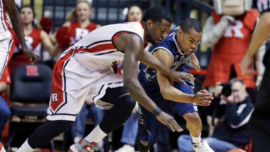 Rutgers' Eli Carter, left, and Georgetown's Markel Starks go after the ball during the first half of an NCAA college basketball game Saturday, Feb. 9, 2013, in Piscataway, N.J. (AP Photo/Mel Evans)