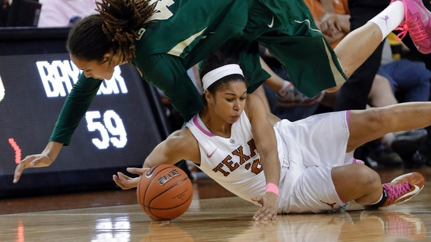 Baylor's Brittney Griner, top, and Texas' Celina Rodrigo (2) scramble for a loose ball during the second half of an NCAA college basketball game, Saturday, Feb. 9, 2013, in Austin, Texas. Baylor won 75-48. (AP Photo/Eric Gay)
