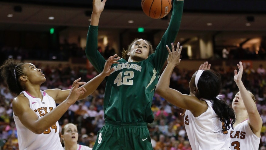 Baylor's Brittney Griner (42) reaches over Texas defenders Imani McGee-Stafford, left, Empress Davenport, second from right, and GiGi Mazionyte, right, for a rebound during the second half of an NCAA college basketball game, Saturday, Feb. 9, 2013, in Austin, Texas. Baylor won 75-48. (AP Photo/Eric Gay)