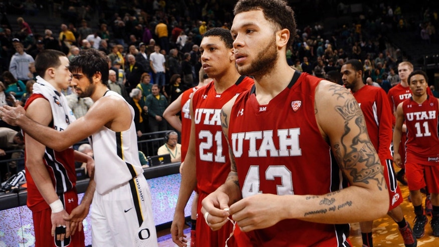 Utah's Jeremy Olsen, left, and Oregon's Arsalan Kazemi meet after the NCAA college basketball game, as Utah's Ryan Osterloh and Jason Washburn leave the court in Eugene, Ore., Saturday, Feb. 9, 2013.Oregon won 73-64.(AP Photo/Chris Pietsch)