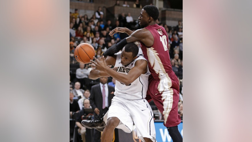 Florida State's Okaro White, right, knocks fouls Wake Forest's Travis McKie during the first half of an NCAA college basketball game in Winston-Salem, N.C., Saturday, Feb. 9, 2013. (AP Photo/Chuck Burton)