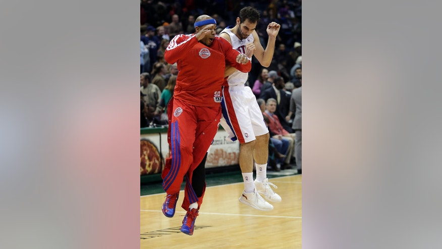 Detroit Pistons' Jose Calderon and Corey Maggette celebrate after an NBA basketball game against the Milwaukee Bucks on Saturday, Feb. 9, 2013, in Milwaukee. The Pistons won 105-100. (AP Photo/Morry Gash)