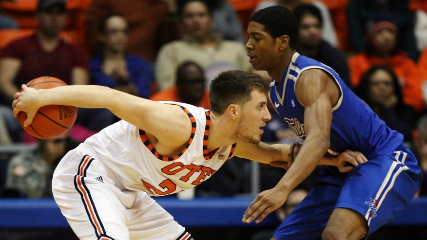 UTEP's Konner Tucker, left, hides the ball from Tulsa's Rashad Smith during the first half of their NCAA college basketball game, Saturday, Feb. 9, 2013, in El Paso, Texas. (AP Photo/The El Paso Times, Victor Calzada)  EL DIARIO OUT; JUAREZ MEXICO OUT; IF USE ON LAM OR LAT AND EL DIARIO DE EL PASO OUT