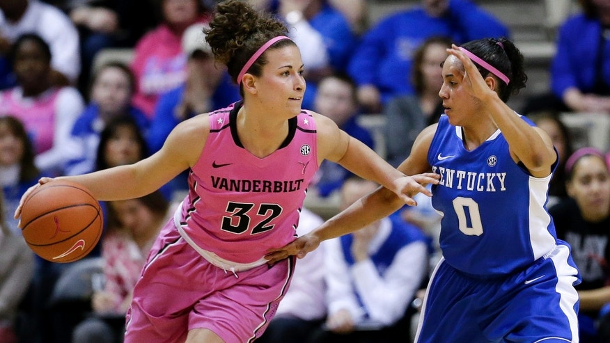 Vanderbilt guard Gabby Smith (32) drives against Kentucky's Jennifer O'Neill (0) in the first half of an NCAA college basketball game, Sunday, Feb. 10, 2013, in Nashville, Tenn. (AP Photo/Mark Humphrey)