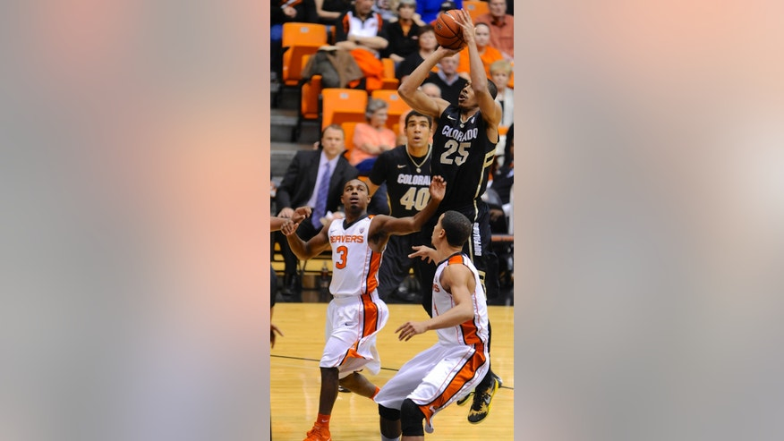 Colorado's Spencer Dinwiddie (25) shoots against Oregon State's Ahmad Starks (3) and Challe Barton during the first half of an NCAA college basketball game in Corvallis, Ore., Sunday, Feb. 10, 2013. (AP Photo/Greg Wahl-Stephens)