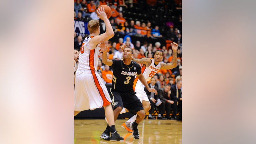 Colorado's Xavier Talton (3) loses the ball to Oregon State's Olaf Schaftenaar (30) during the first half of an NCAA college basketball game in Corvallis, Ore., Sunday, Feb. 10, 2013. (AP Photo/Greg Wahl-Stephens)