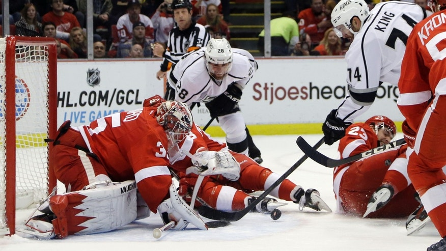 Detroit Red Wings goalie Jimmy Howard (35) stops a shot by Los Angeles Kings center Dwight King (74) during the first period of an NHL hockey game in Detroit, Sunday, Feb. 10, 2013. (AP Photo/Carlos Osorio)