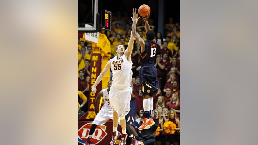 Illinois' Tracy Abrams (13) shoots a 3-pointer over Minnesota's Elliott Eliason (55) towards the end of the second half of an NCAA college basketball game, Sunday, Feb. 10, 2013, in Minneapolis. Illinois won 57-53. (AP Photo/Genevieve Ross)