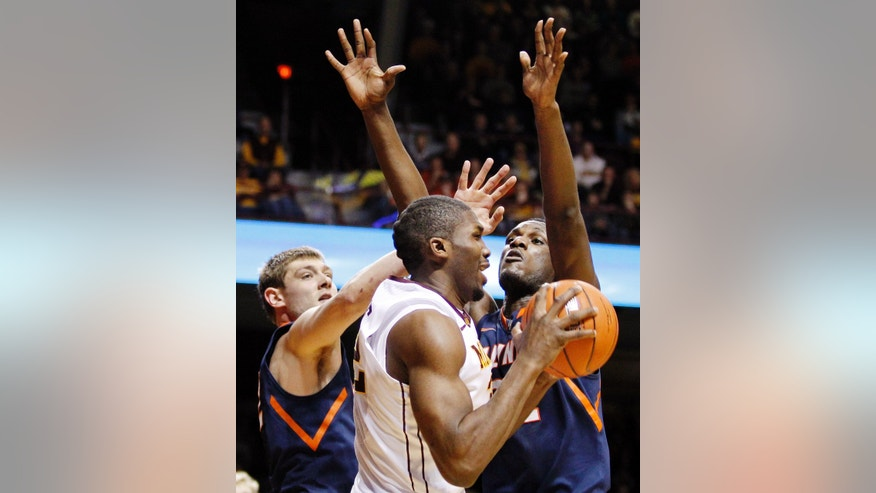 Minnesota's Trevor Mbakwe, center, is double-teamed by Illinois' Tyler Griffey, left, and Nnanna Egwu, right, during the second half of an NCAA college basketball game, Sunday, Feb. 10, 2013, in Minneapolis. Illinois won 57-53. (AP Photo/Genevieve Ross)