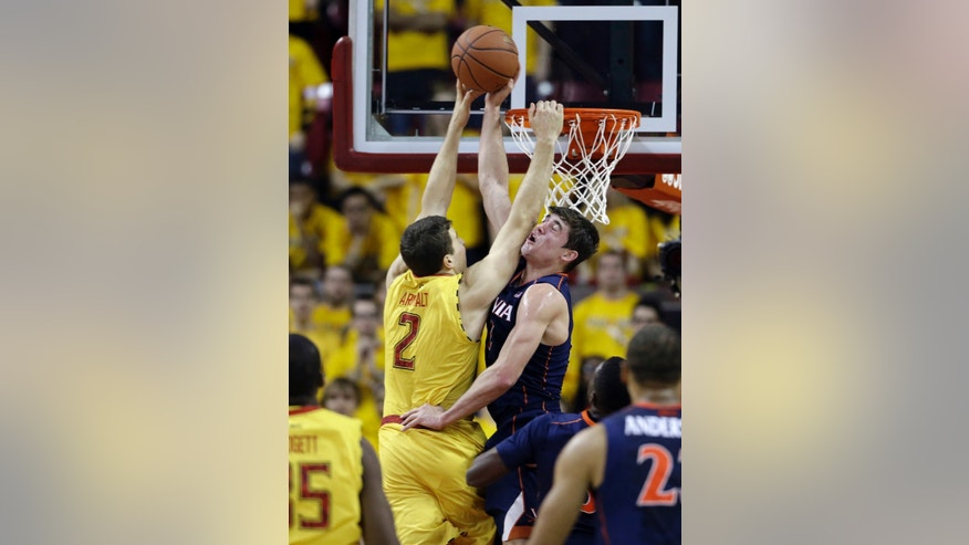 Virginia guard Joe Harris, top right, blocks a shot attempt by Maryland guard Logan Aronhalt in the first half of an NCAA college basketball game in College Park, Md., Sunday, Feb. 10, 2013. (AP Photo/Patrick Semansky)