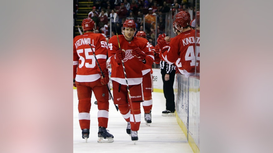 Detroit Red Wings center Damien Brunner (24) of Switzerland is congratulated by teammates after scoring a goal during the first period of an NHL hockey game against the Los Angeles Kings in Detroit, Sunday, Feb. 10, 2013. (AP Photo/Carlos Osorio)
