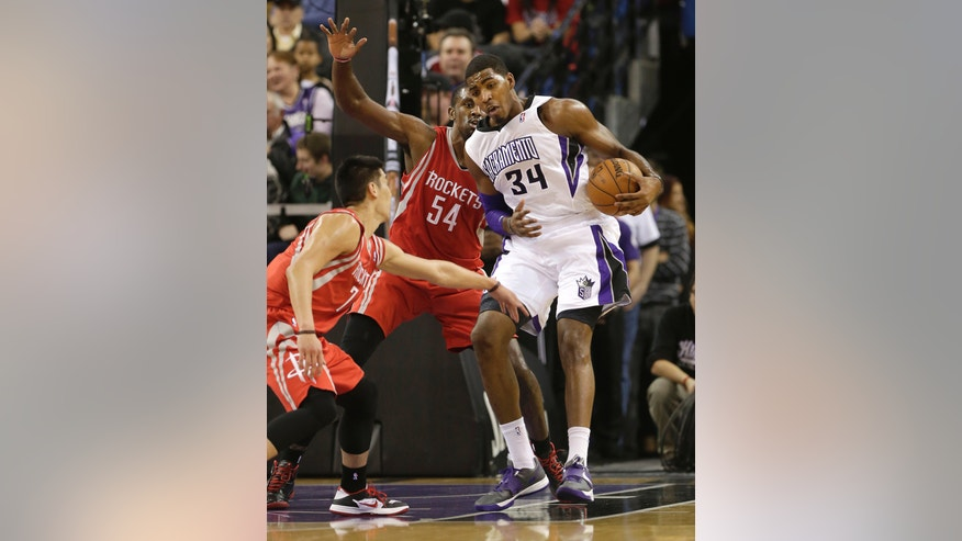 Sacramento Kings forward Jason Thompson, right, tries to work out of the double team of Houston Rockets' Jeremy Lin, left, and Patrick Patterson, center during the first quarter of an NBA basketball game in Sacramento, Calif., Sunday, Feb. 10, 2013.(AP Photo/Rich Pedroncelli)