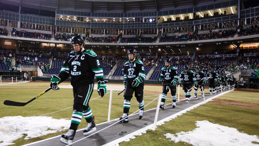 North Dakota players walk to the rink before the second period as they play Nebraska-Omaha in an NCAA college hockey game at TD Ameritrade Park in Omaha, Neb., Saturday, Feb. 9, 2013. (AP Photo/Nati Harnik)