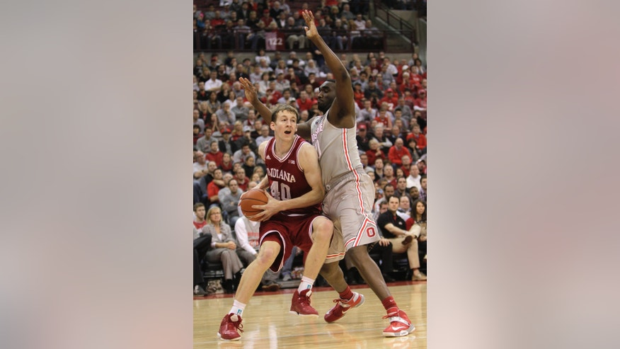 Indiana's Cody Zeller, left, drives the baseline against Ohio State's Evan Ravenel during the second half of an NCAA college basketball game Sunday, Feb. 10, 2013, in Columbus, Ohio. Indiana defeated Ohio State 81-68. (AP Photo/Jay LaPrete)